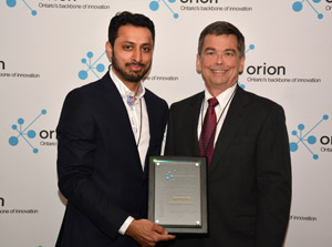 Bill Summers presents Alan Darnell the Higher Education award, accepted by Amaz Taufique.