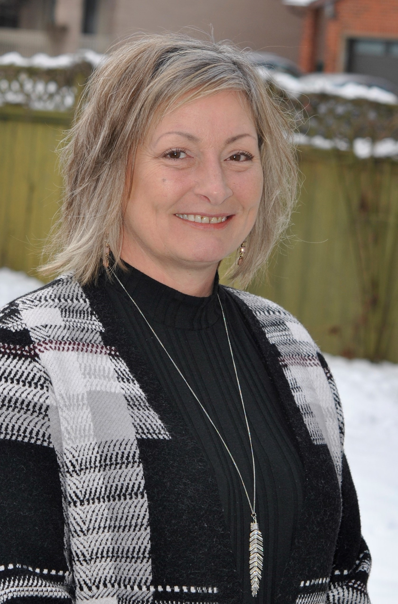 A headshot of Denise, a speaker in the discussion